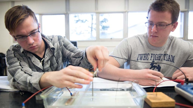 students in physics lab