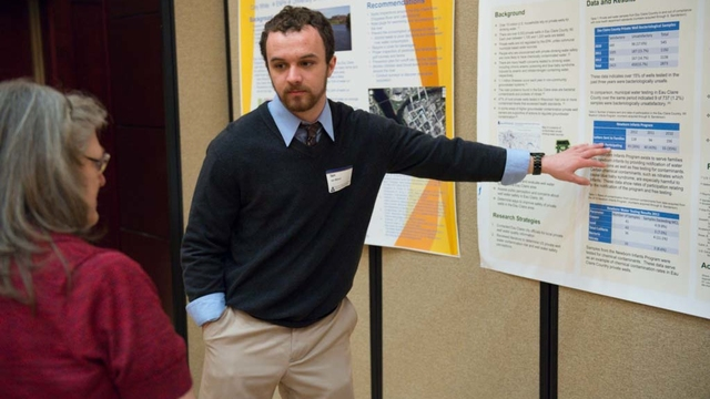 Student presenting research