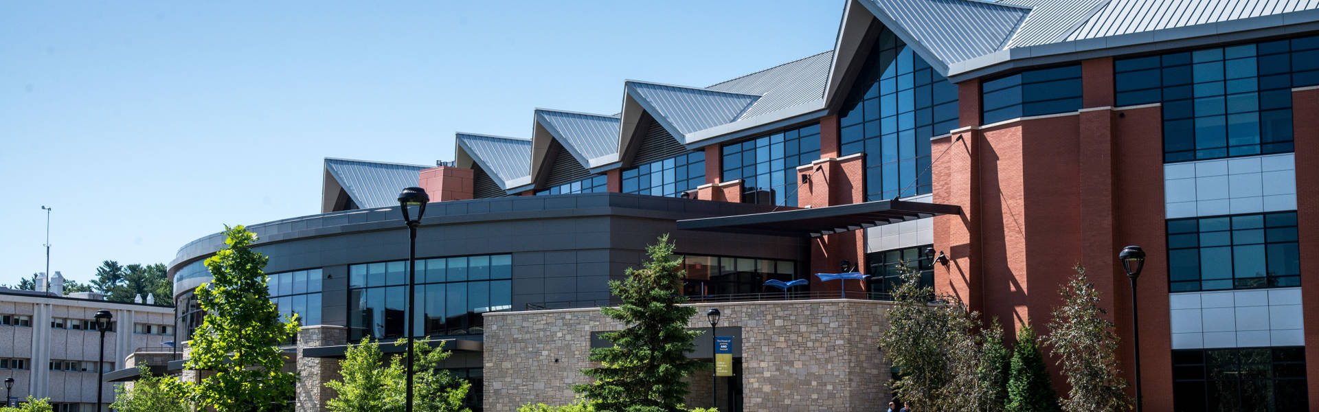 Exterior view of Davies Center in the summer