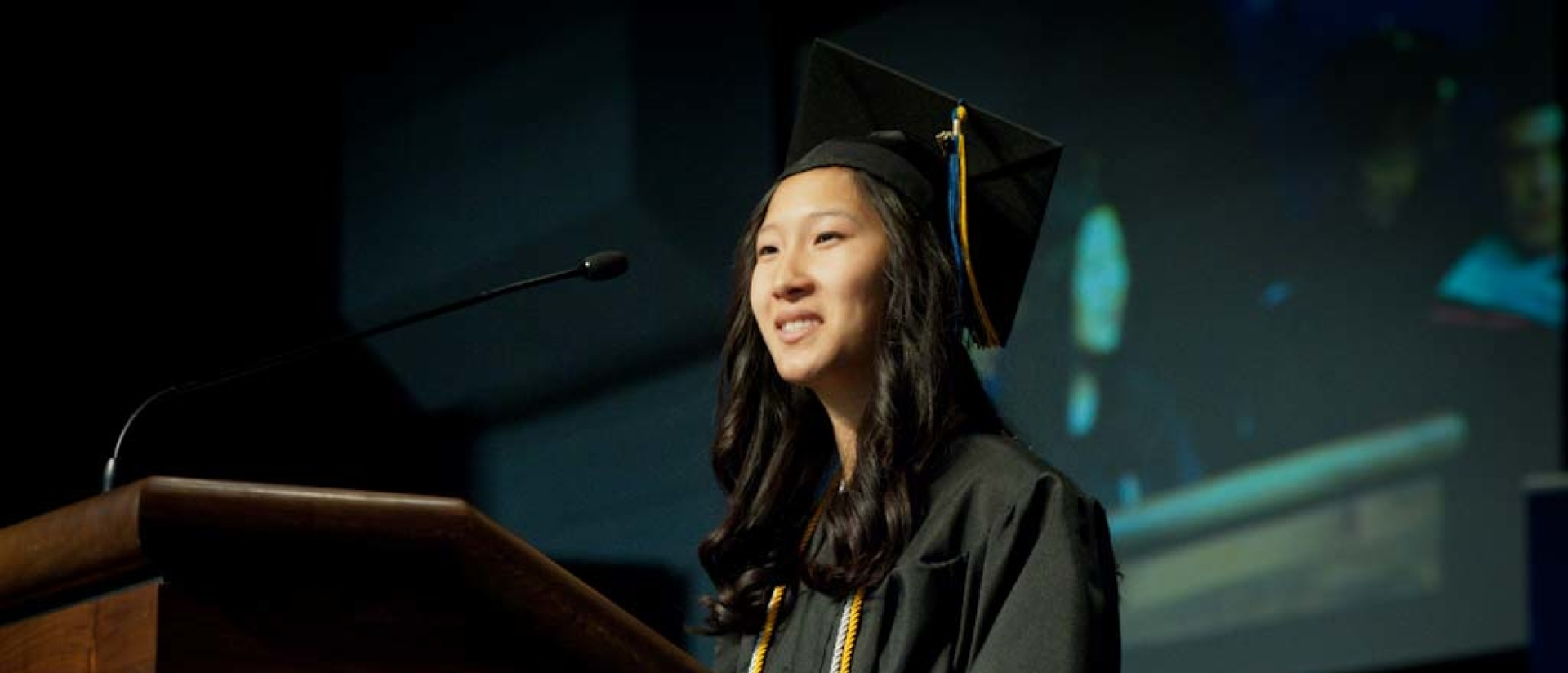 Student speaking at commencement.