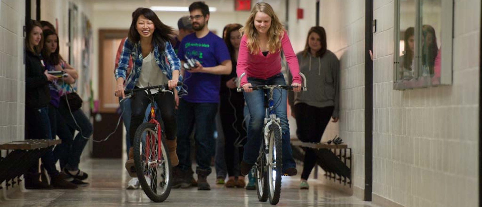 Students riding on bikes for math day