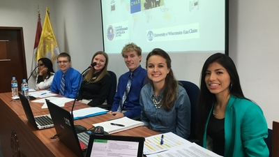 Blugold students present their research to Peruvian educators in Lima.