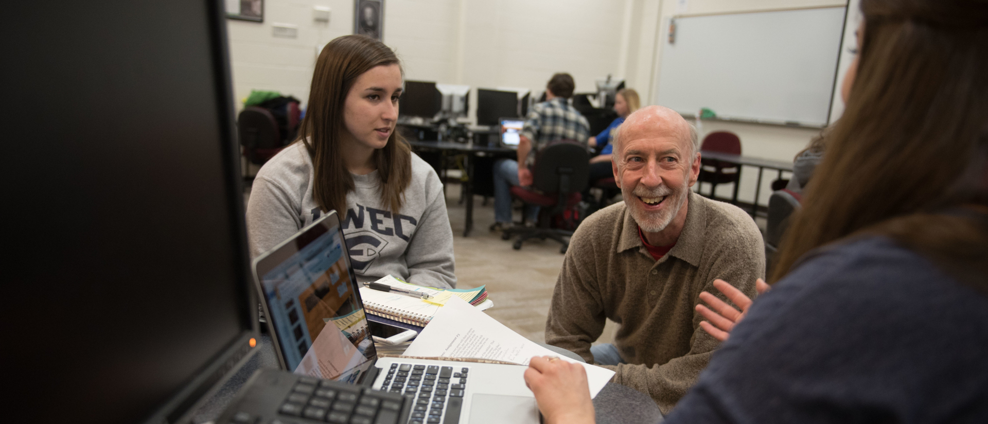 A professor working with students.