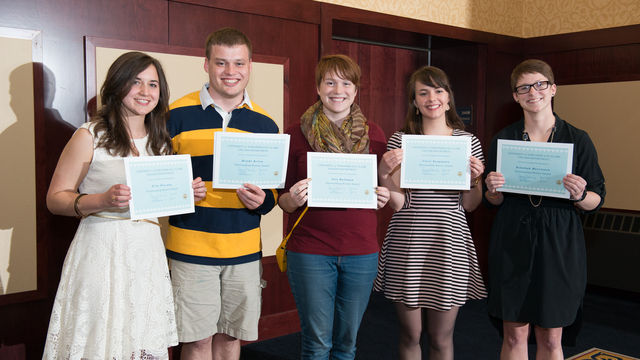 UWEC students posing with scholarships