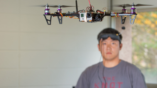 UWEC student working with drone
