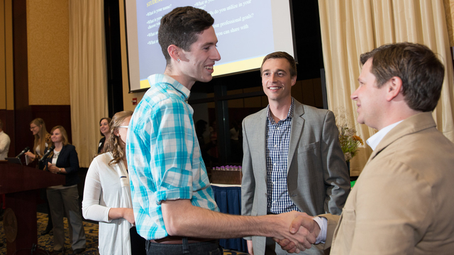 Student shaking hands at networking event
