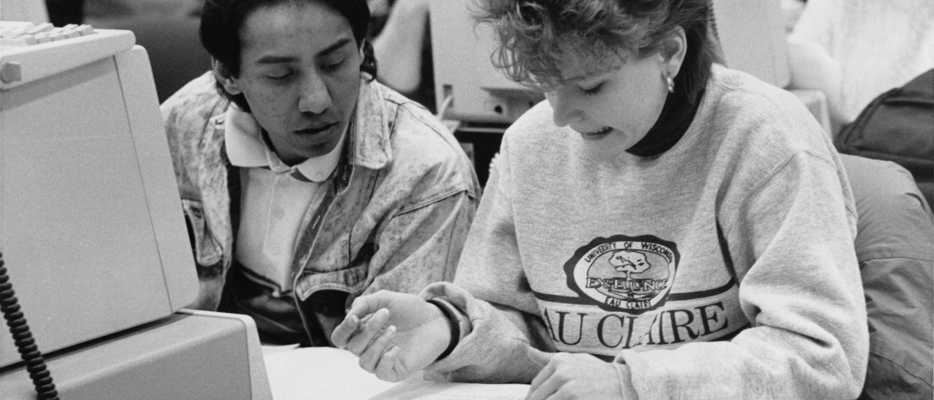 Two students at a PC.