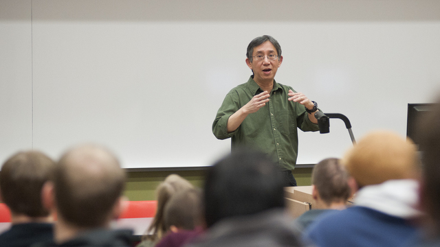 Professor Tan teaching Computer Science