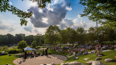 Music lovers in Eau Claire enjoying the Sounds Like Summer Concert Series in Phoenix Park.