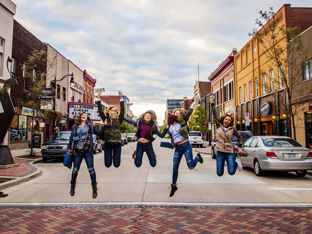 Blugolds jumping in street downtown for UW meets EC