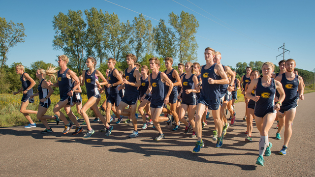 UWEC men's and women's cross country team running.