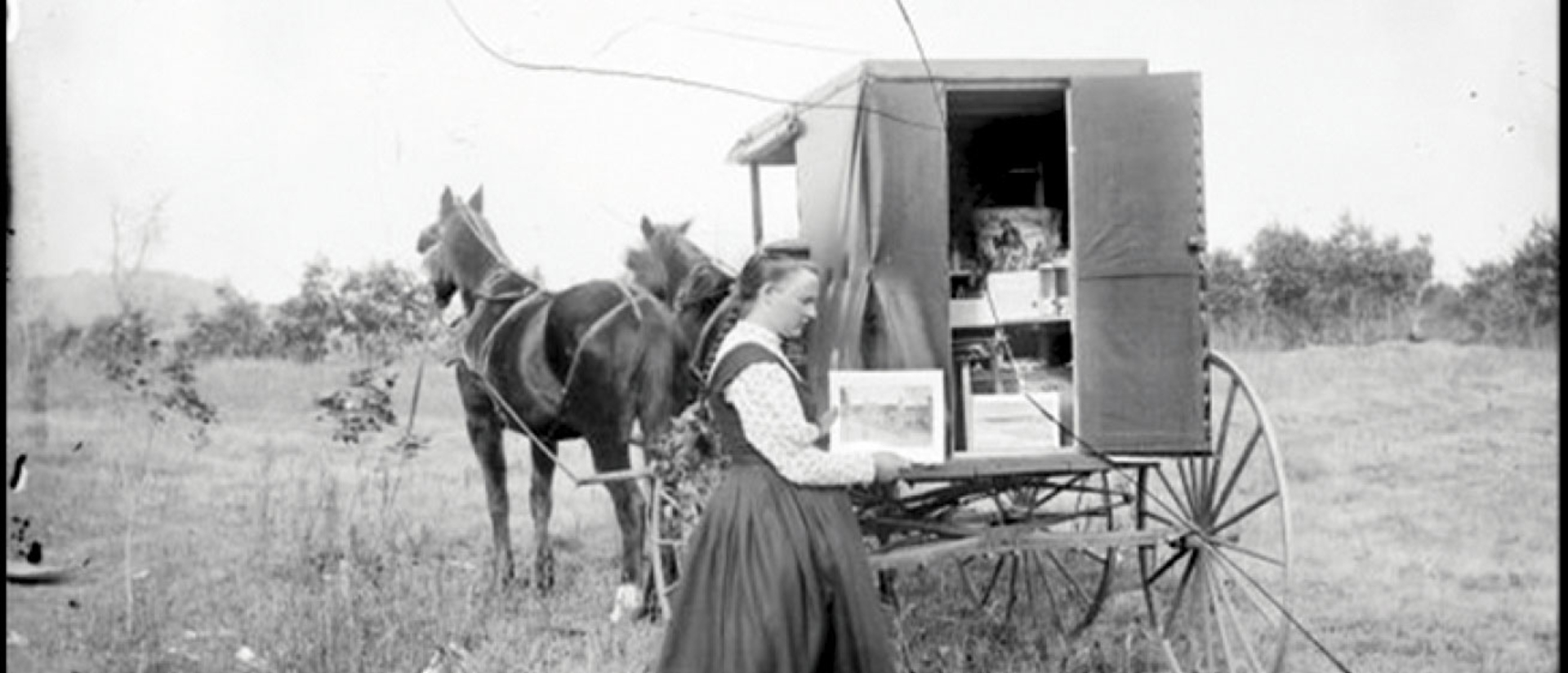 "Photo used in ""Fauxtography"" exhibit, woman by a wagon"
