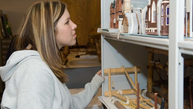 Student studies artifacts at a museum