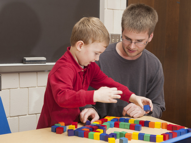 Student working with a child