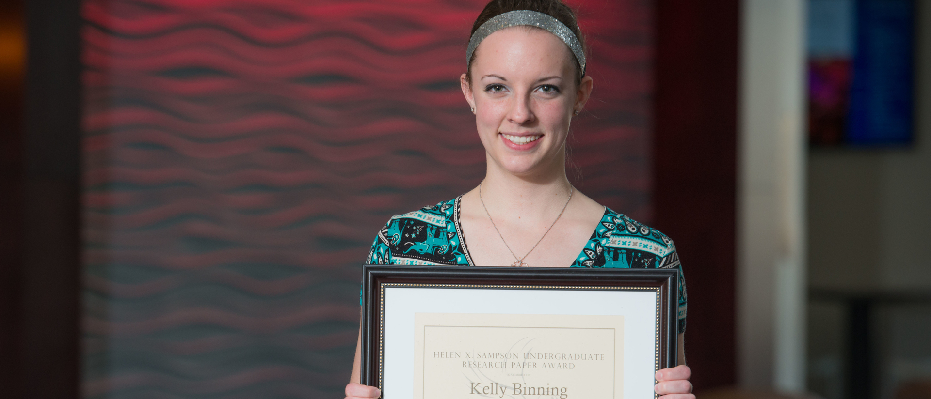 Student Kelly Binning with research award