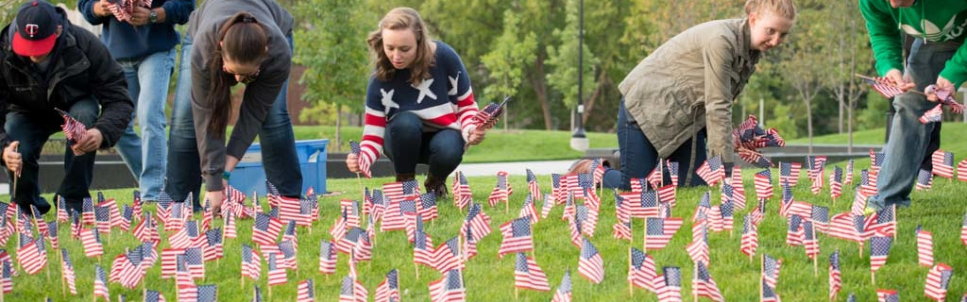 Students place U.S. flags on the UW-Eau Claire campus mall in honor of Veterans Day.