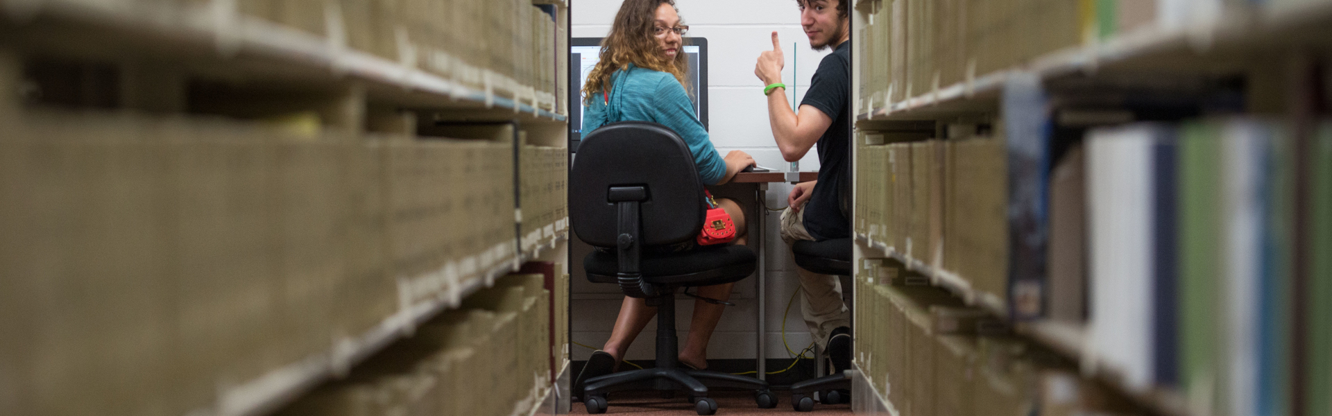Students in the stacks of McIntyre library