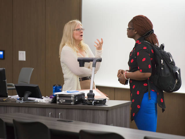 Instructor Patricia Turner talking to student in the classroom
