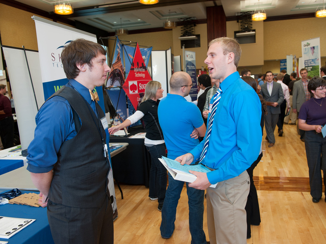 Internship fair students talking.