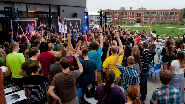Students cheering for a band outside Davies Center.