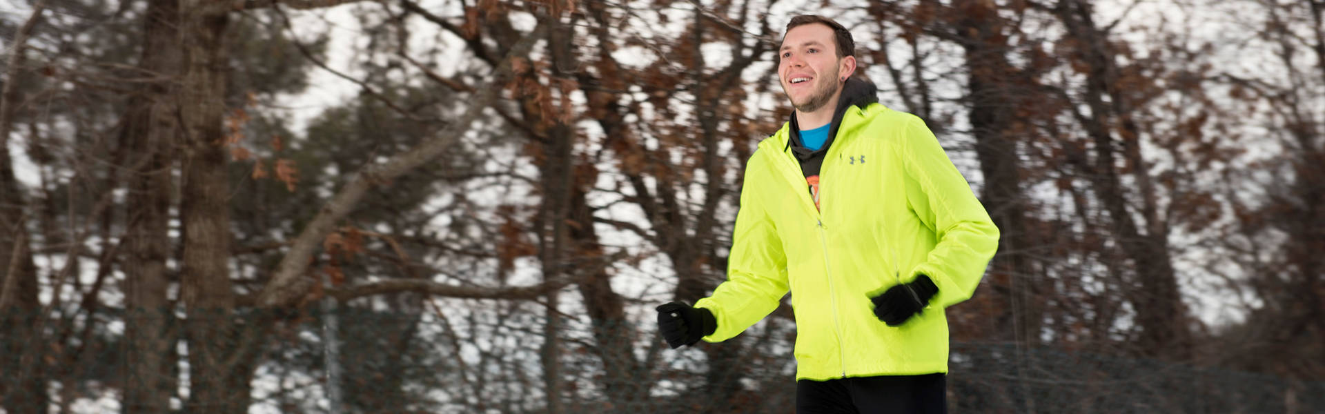 Student running during the winter season.