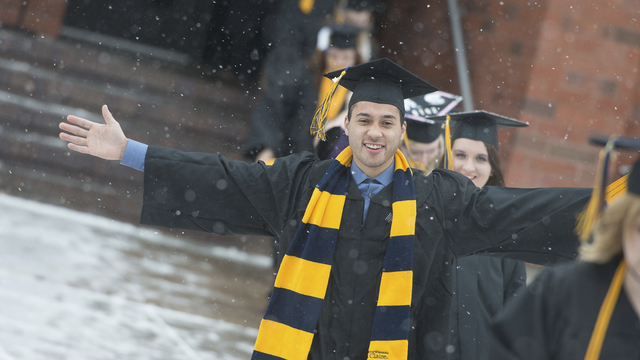 winter commencement graduate in the snow