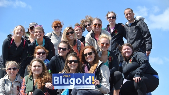 Students holding a Blugold sign