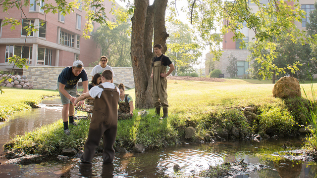 Students wearing waiters in the Little Niagara stream.