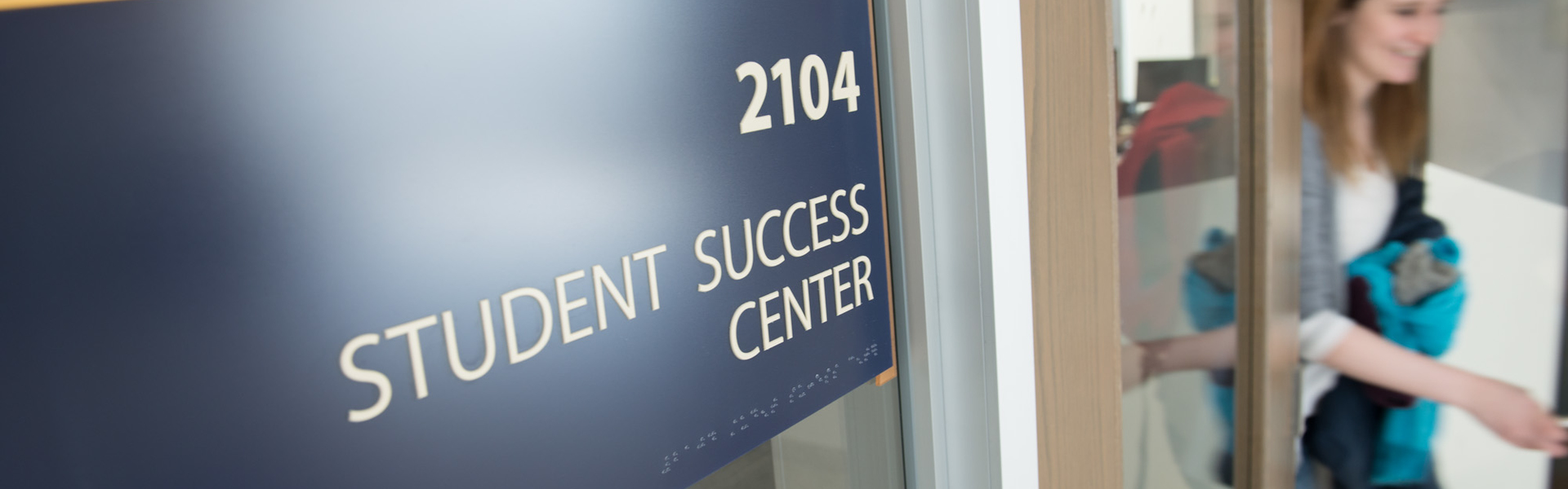 Student leaving the Student Success Center with a wonderful smile on her face