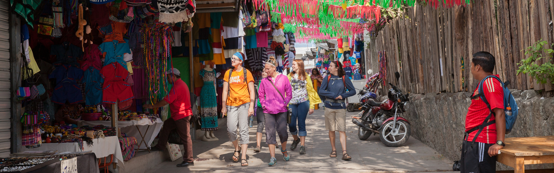 Students walk through street market in Guatemala