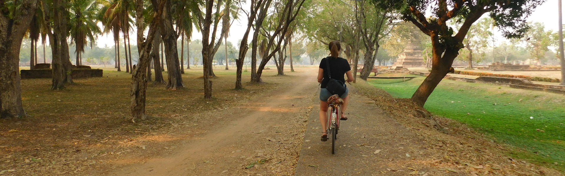 Young woman riding a bike in Chiang Mai, Thailand