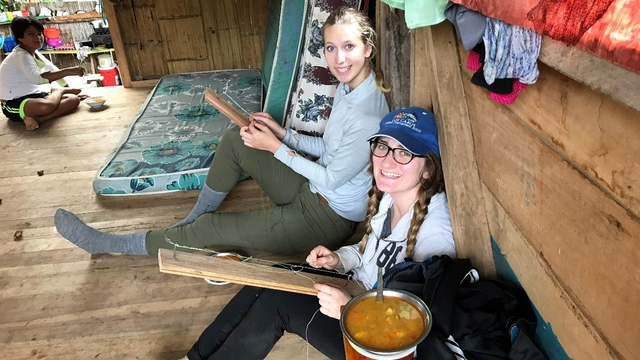 Blugold Hailey Nelson (right) and her host sister spent time at her host family's home making necklaces during Nelson's immersion program in Ecuador. The necklaces were for the traditional Kichwa dance that was held later that day.