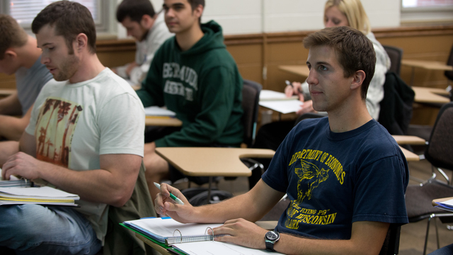 Student in class wearing the economics department T-shirt.