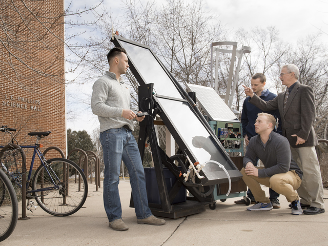 Dr. Kim Pierson discusses the solar-powered water heater with research students Brendon Kwick, Sawyer Buck and Hunter Hermes.