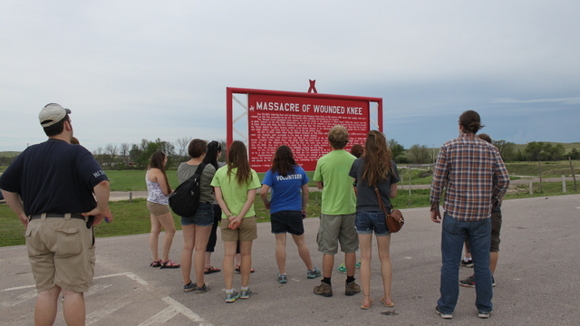 Students on the Pine Ridge immersion trip at the Wounded Knee Memorial