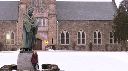Sarah Westad stands in front of the statue of Martin Luther at Wartburg Seminary in Dubuque, Iowa.
