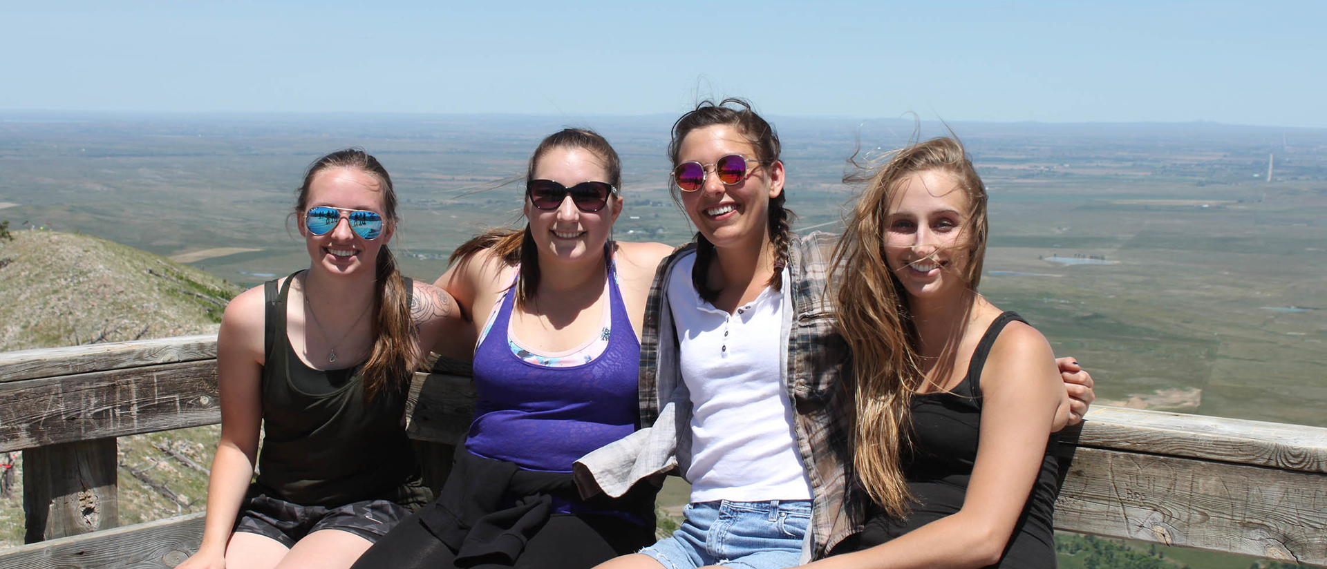 Taylor Younkle and other AIS students on the Pine Ridge immersion experience. Pictured at Badlands National Park.