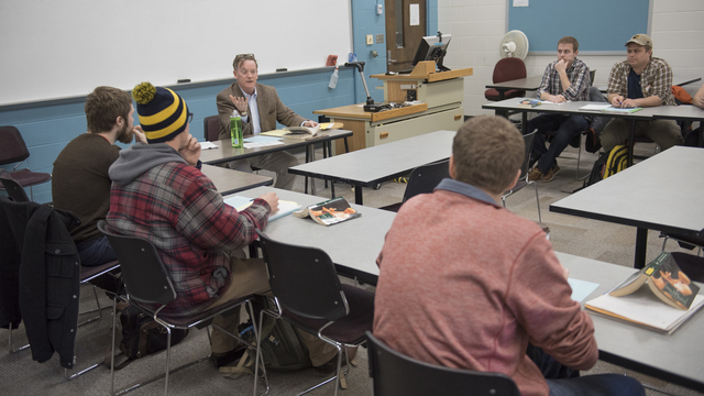 Dr. McAleer and students in philosophy class