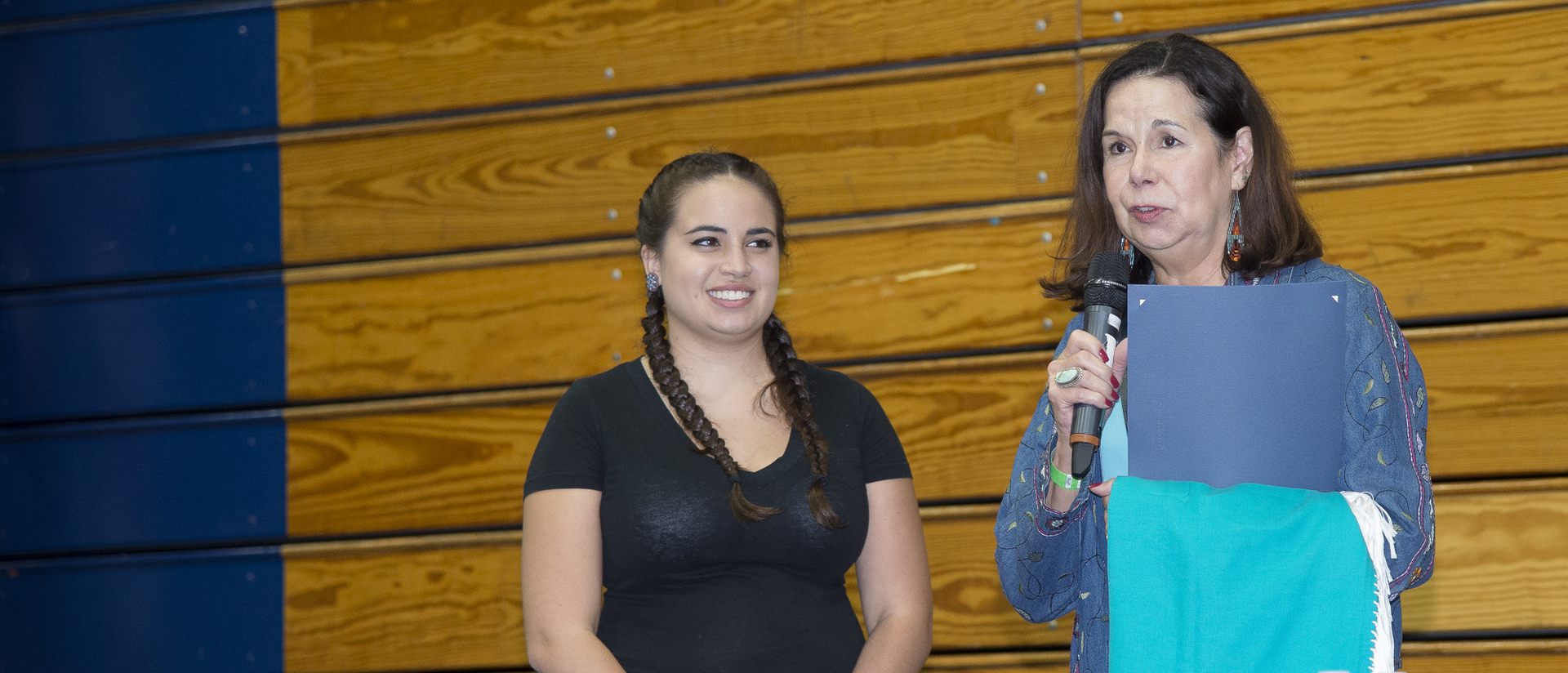 Student receiving a scholarship at the Honoring Education Powwow