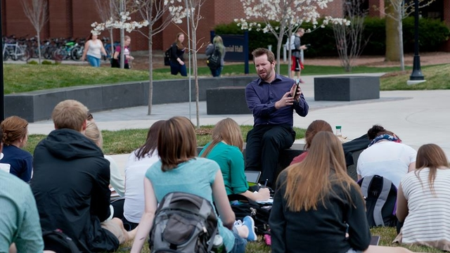 faculty member teaching outside