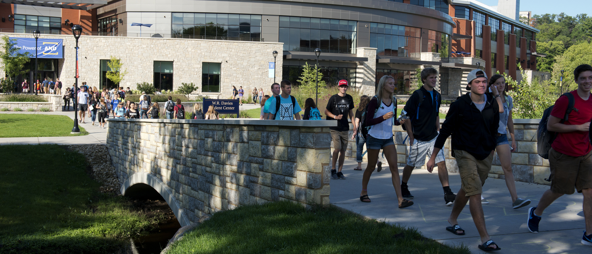 First day of school. Students walking over the bridge that leads to Davies.