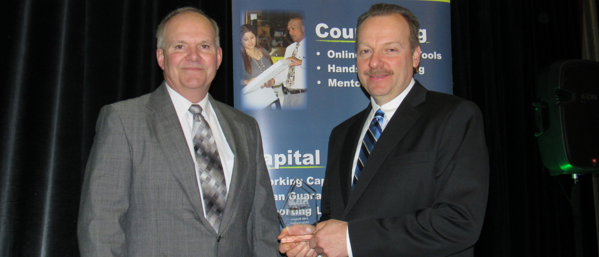 Dave Kochendorfer (left) and Luke Kempen accept Wisconsin's 2017 Small Business Development Center of Excellence and Innovation Award.