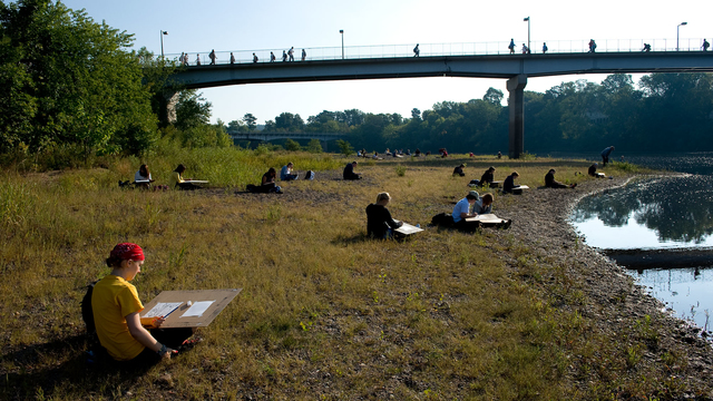 Art students drawing down by the river.