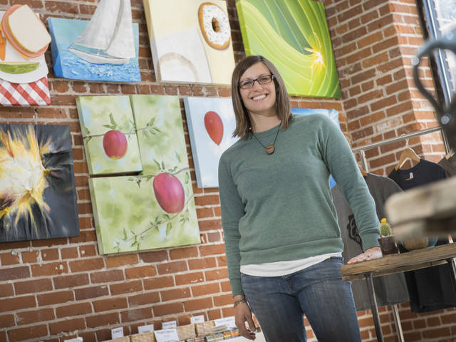 UW-Eau Claire alumna Erin Klaus in her downtown Eau Claire business, Tangled Up In Hue