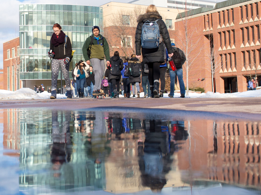 Students walking on campus on a sunny winter day.