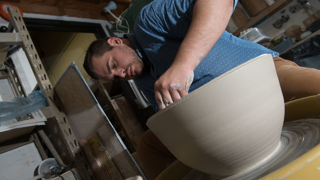 Student at pottery wheel