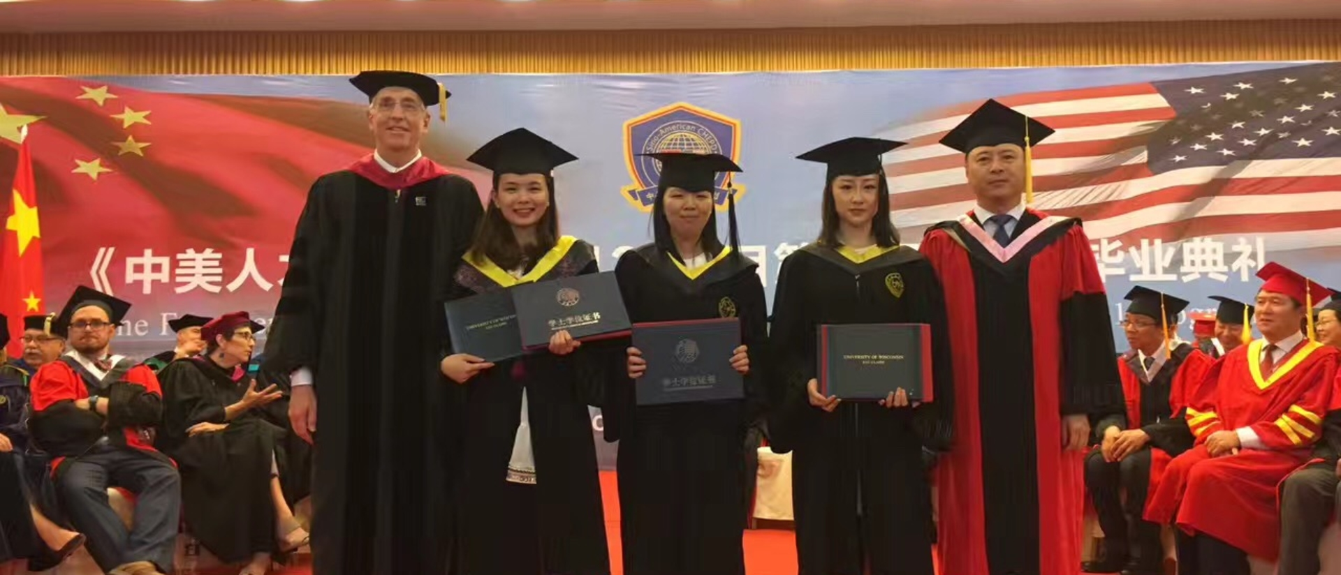 Dr. Michael Carney and graduates of the China 1-2-1 program.