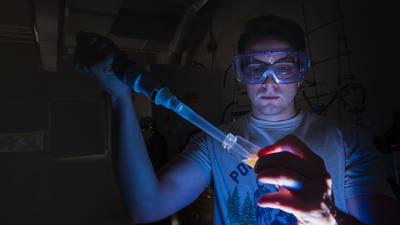 UWEC material science and engineering student working in lab