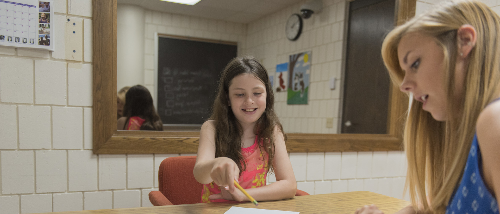 Sophie Topper, 9, is building her math skills and confidence through her work with school psychology graduate student Jill Heitman.