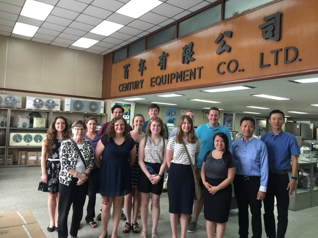 Professor DaCosta and students inside Century Equipment Company in China.